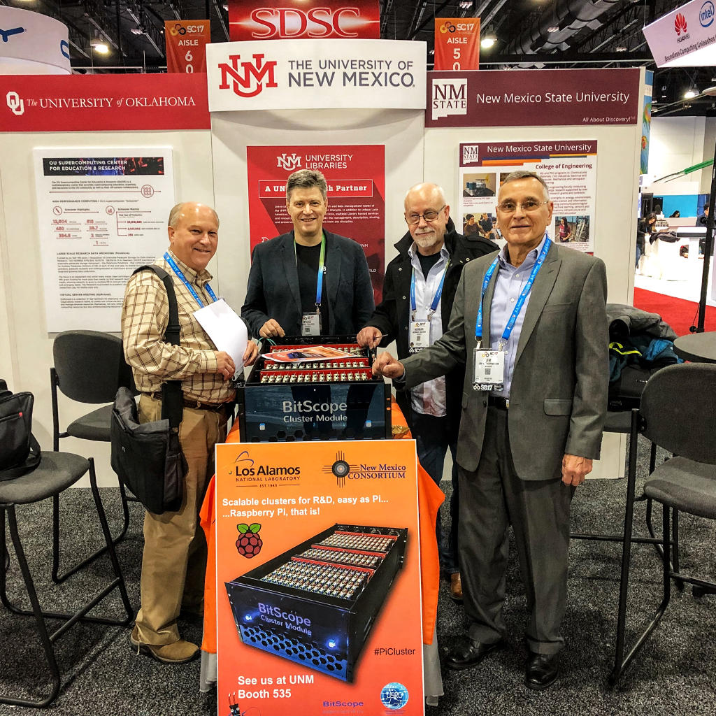 Gary, Bruce, Norman and Jim at the UNM Booth with the BitScope Cluster Module